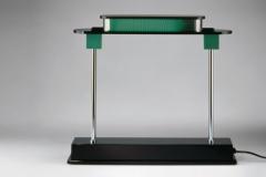 59-artemide-lampe-à-poser-table-pausania-679x382